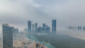 Buildings on Al Reem island in Abu Dhabi timelapse from above. Skyscrapers on Al Reem Island in Abu Dhabi timelapse from above. Aerial citiscape from Al Reem stock video footage