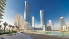 Buildings on Al Reem island in Abu Dhabi timelapse hyperlapse. Skyscrapers on Al Reem Island in Abu Dhabi timelapse hyperlapse from beach. Citiscape from Al Reem stock footage