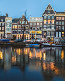 Buildings along the Amsterdam Canals at twilight Royalty Free Stock Image
