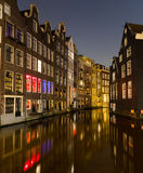 Buildings along the Canals in Amsterdam at Night Royalty Free Stock Photos