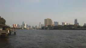Buildings along Chao Phraya River in Bangkok, Thailand. Royalty Free Stock Image