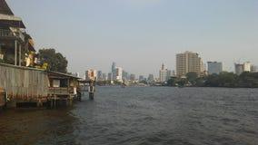 Buildings along Chao Phraya River in Bangkok, Thailand. Stock Photos