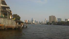 Buildings along Chao Phraya River in Bangkok, Thailand. Stock Photo
