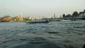 Buildings along Chao Phraya River in Bangkok, Thailand. Stock Images