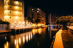 Buildings along Collins Canal at night, in Miami Beach, Florida. Royalty Free Stock Photo