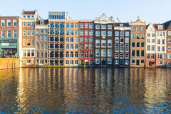 Buildings along the Damrak during the day in Amsterdam Royalty Free Stock Photography