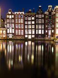 Buildings along the Damrak at Night in Amsterdam Stock Image