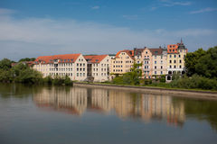 Buildings Along the Danube River. A photo of buildings along the Danube River in Germany. The buildings are reflecting in the river water Stock Image