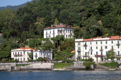 Buildings along Lake Como, Italy. Luxury villas and hotels along the shore of Lake Como, Italy.  Buildings are white stucco with red-clay roofing tiles Stock Image