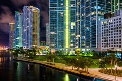 Buildings along the Miami River at night, in downtown Miami, Flo Stock Image