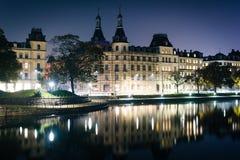 Buildings along Peblinge Sø at night, in Copenhagen, Denmark. Royalty Free Stock Photo