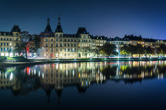 Buildings along Peblinge Sø at night, in Copenhagen, Denmark. Stock Image