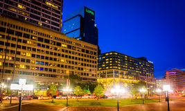Buildings along Pratt Street at night in Baltimore, Maryland. Stock Images