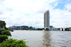 Buildings along the river. The view from Santi Chai Prakan Park. Stock Image