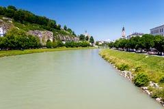 Riverfront in Salzburg, Austria. Buildings along riverfront in sunny Salzburg, Austria stock photo