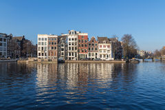Buildings along Staalkade Street and the Amstel Canal Royalty Free Stock Image