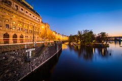 Buildings along the Vltava at twilight, in Prague, Czech Republi Royalty Free Stock Photo
