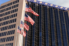 Buildings and American flags . Stock Image