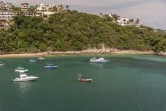 Free Buildings And Boats In Santa Cruz Huatulco Mexico Royalty Free Stock Photography - 136946077