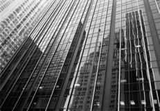 Buildings around a square reflected in glass facade Stock Image