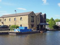 Free Buildings Around The Brighouse Basin With Moored Boat On The Calder And Hebble Navigation Canal In Calderdale West Royalty Free Stock Photography - 159698357