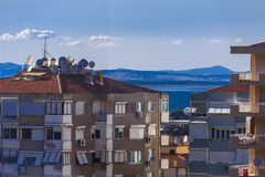 Buildings in Balcova - Izmir Turkey. Panorama of buildings of Balcova - Izmir Turkey. On the background a beautiful blue sky is over the hills and the sea Stock Photo