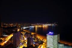 Buildings on the beach at night Stock Photos