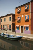 Buildings and Boat on Canal in Venice Stock Photo
