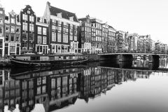 Buildings and boats along the Amsterdam Canals in Black and Whit Stock Image