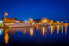 Buildings and boats along the waterfront at night, in Annapolis, Royalty Free Stock Images