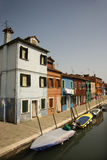 Buildings and Boats on Canal in Venice Stock Photography