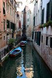 Buildings and boats on canal in Venice, Italy Stock Photography