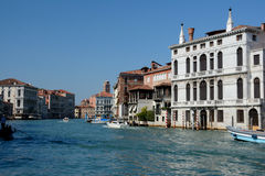 Buildings and boats on canal in Venice, Italy Stock Photo