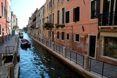 Buildings and boats on canal in Venice, Italy Stock Images