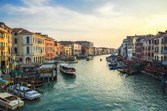 Buildings, boats and Gondolas in Venice, Grand Canal. View from Rialto Bridge. Colorful venetian cityscape royalty free stock photo