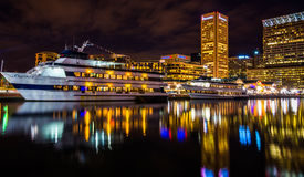 Buildings and boats reflecting in the Inner Harbor at night, Bal Royalty Free Stock Image