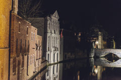 Buildings and Bridge over Canal at Night in Bruges Royalty Free Stock Photo
