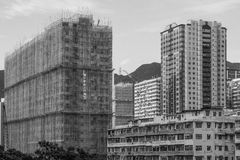 Buildings and a building under construction. A building and a building under construction stands next to it. It is quite contrastive. Taken from Hong Kong Royalty Free Stock Images