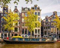 Buildings on canal in Amsterdam Royalty Free Stock Photo