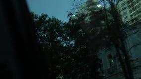 Buildings through car window. City street through car window stock video