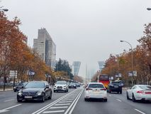 Buildings and cars of a big city in the fog royalty free stock photo