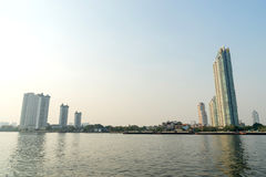 Buildings on Chaophraya riverside in evening Royalty Free Stock Image