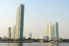 Buildings on Chaophraya riverside in evening Stock Photography