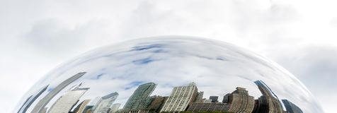 Buildings of Chicago reflected on the Cloud Gate. In a cloudy day Royalty Free Stock Photo