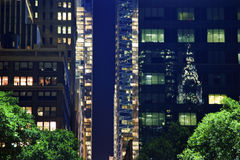 Buildings Chrysler Refflection Abstract NYC. Chrysler Building Reflection, Apartment Buildings Bryant Park New York City Night Royalty Free Stock Photos