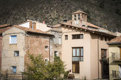 Buildings and the church in Noguera de Albarracin Royalty Free Stock Images