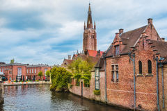 Buildings and the Church of Our Lady in Bruges Stock Images