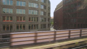 Buildings in the city of berlin from window view of a moving train.  stock footage