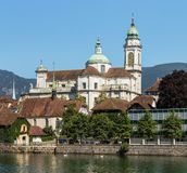 Buildings of the city of Solothurn along the Aare river. Buildings of the historic part of the city of Solothurn along the Aare river, towers of the famous St royalty free stock photography