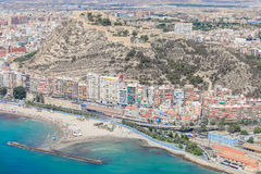 Buildings on the coast of Alicante, and castle Stock Images